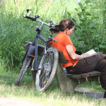 Why I need an Editor Proofreader image of a woman on a bench with a book