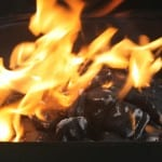 Charcoal burning in a fire