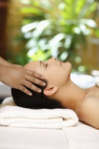 Goal SPA Units are refreshing. Photo is of a woman receiving a scalp massage in a spa.
